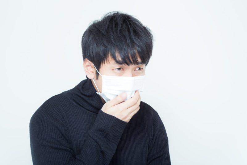 咳をする人